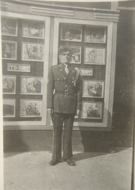 WW II vet in front of Grand Theater