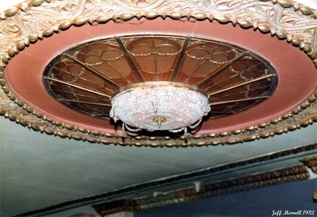 Ornate lighting under the balcony