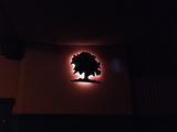 Oak light on wall of main auditorium