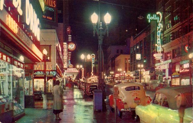Circa 1950 photo via Flickr, Paramount vertical sign in the far background center.