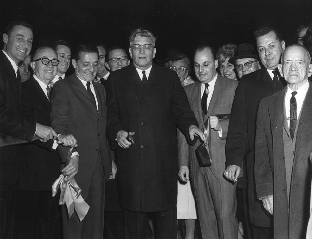 Charles Tannenbaum, George Schwartz, William Milgram, Donald Milgram, Mayor, Otto Bruyns, Henry Milgram at opening ceremony December 23, 1965 Milgram