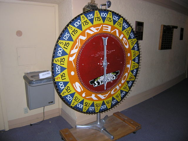 Rhode Vintage 1937 Carnival Wheel On Display In Lobby