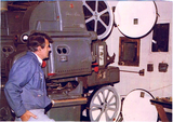 "<p>Projectionist is the late Raymond H. Goodman, my mentor.  I learned the projection craft in this booth, starting in 1974, when I was 12.  Equipment was Century C projectors with 4"" lens barrels, RCA 9030 soundheads, Ashcraft (RCA-badged Dyn-Arc) carbon arc lamps running an 11mm trim, Hertner Transverter generator, RCA field amplification.  The 3D floating reels and magazines were from the closed Strand Theatre.</p>"