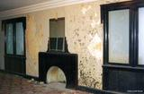 <p>A view of the upper level lounge which occupied the area in front of the house over the lobby.  There had been severe roof leaks which, at the time, had compromised the structural integrity of the front wall of the building.  At one point the room was painted in some very bright colors.</p>