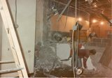 <p>23 – removing debris as wall between the lobbies is removed, 1988.</p>