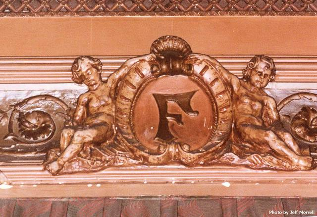 Cartouche at the top of the proscenium arch