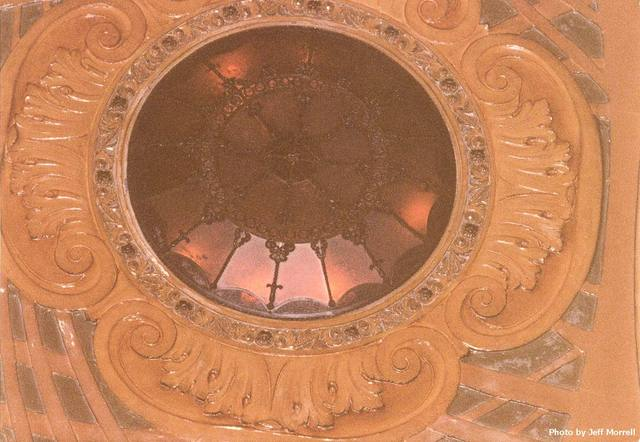 One of the flush leaded glass lighting fixtures in the auditorium ceiling