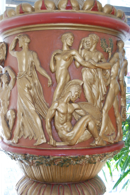 Detail of large figurative urns salvaged from the Carolina Theater.