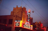<p>This picture was taken in the very early evening before the sea of white lights below the marquee was switched on. As stated in the general introduction, the Metro was wholly designed in the United States, in the offices of MGMs Lowes Theatres. The noted Adelaide theatre architect Kenneth Milne interpreted the plans and erected the building. The marquee was the only example of its distinctively American kind in Australia. The theatre was fully air-conditioned for Adelaide's hot Mediterranean type summers and cool winters, but didn't really need the anti-snow devices, as snow has never fallen in the city since its foundation in 1836.</p>