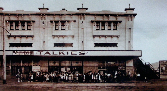 A Matinee crowd waiting for a tram – very early sound era.