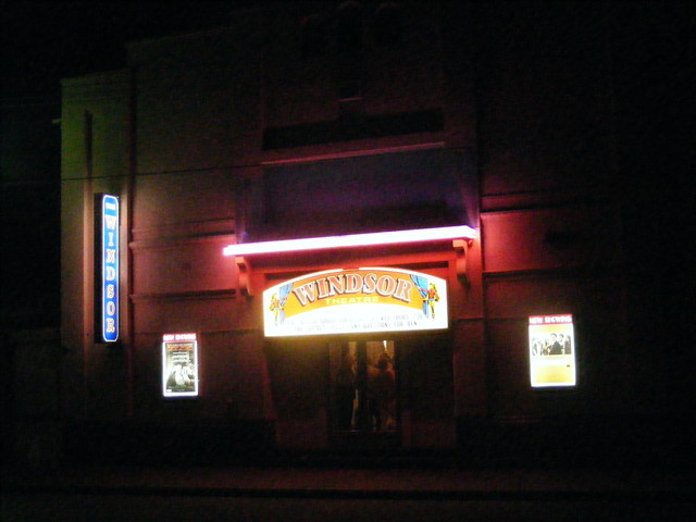 A bright façade at night.