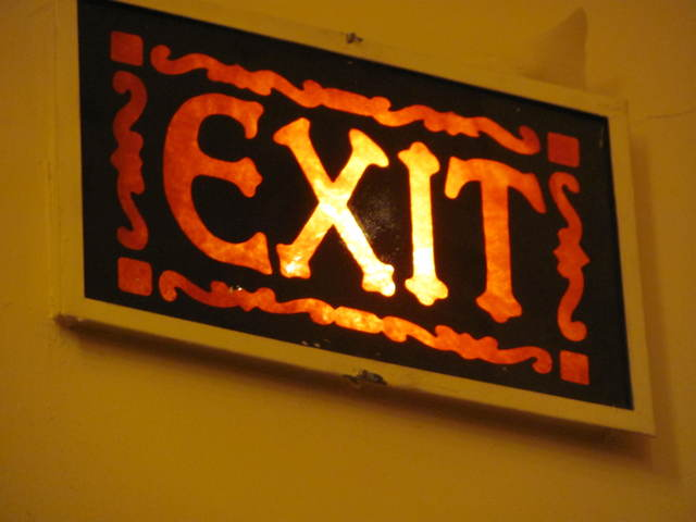 RHODE, Kenosha, Wisconsin. This original GATEWAY-era exit lamp is on the wall between the grand lobby and the outer vestibule.