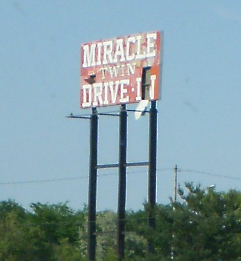 Miracle Twin DI freeway sign