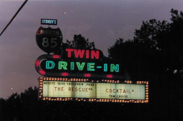 STOREY'S NORTH 85 DRIVE IN THEATRE marquee at night