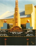 "<p>Daytime photograph of complex taken in early 1986, shortly after Christmas '85 Grand Opening.  The ""Six-Track Dolby"" marquee notation for ""Out of Africa"" was a misnomer (theatre would not have its first 70mm/Six-Track presentation until its summer run of ""Aliens"" months later). Photo Source:  1996 Winning Shopping Center Designs, ICSC, p. 83.</p>"