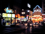 "<p>Night shot of Plaza Theatre playing ""The Man Who Shot Liberty Valance"" in 1962. At left is newly remodeled Capri Theatre which would soon be modified again to show Cinerama films.</p>"