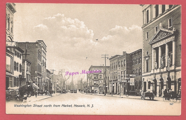 Post card view of Washington St., showing the Empire Theatre atthe right side