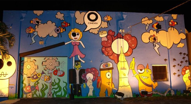The new mural in front of O Cinema