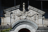 <p>Detail work at parapet above original Broadway entrance</p>