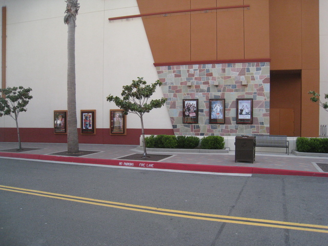 Side of the building, posters of films currently showing at the theater.