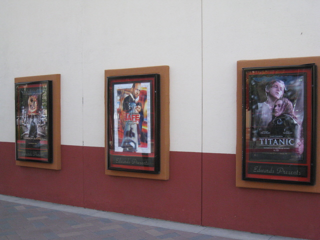 Posters on the side of the building.