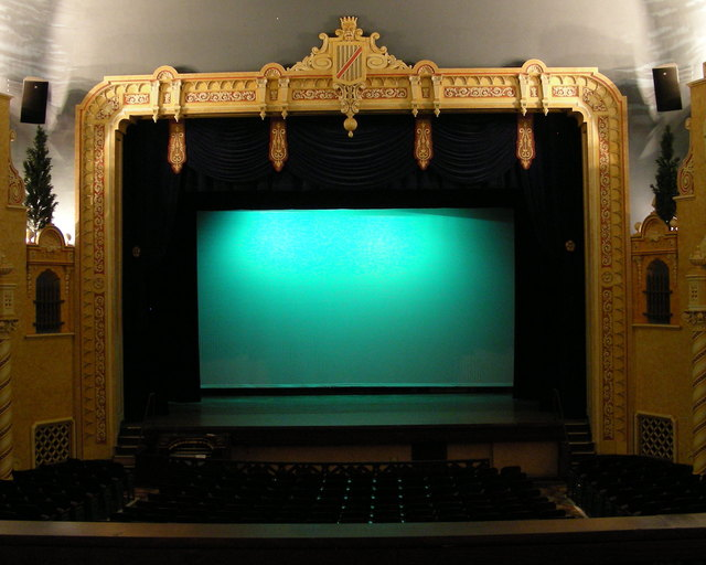 Stage, movie screen and curtains