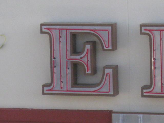 "Edwards Cineams ""E"" on the southwest face of the building"