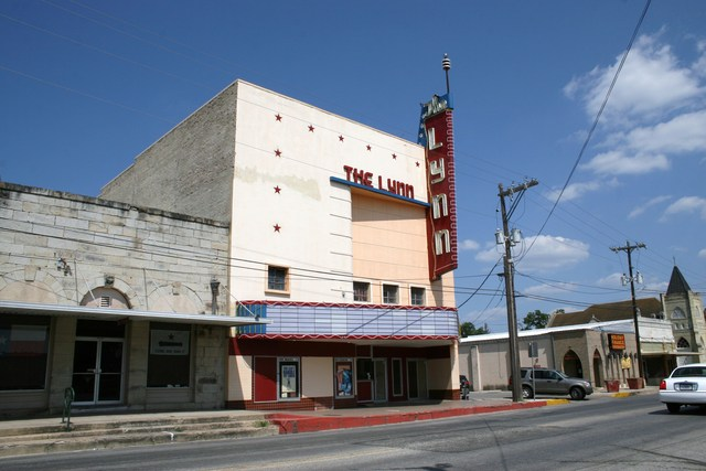 Lynn Theatre with a blue, cloud-filled sky