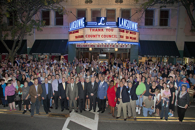 Supporters gather under newly relit Lansdowne Theater Marquee