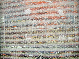 Ghost Sign on north wall of stage house 