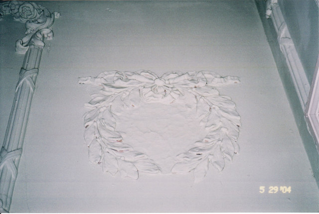Plaster wreath decoration on lobby wall