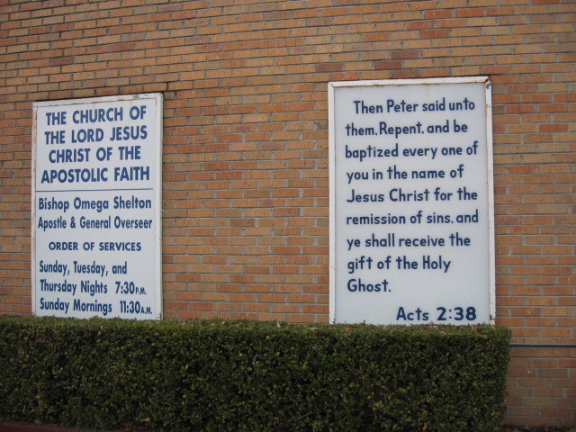 Church signs on the Esquire building.