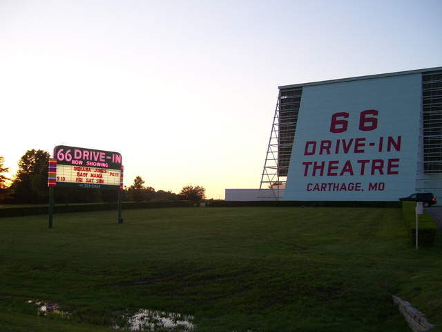 Sign lit at dusk