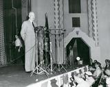 """[""""Eisenhower throwing his hat in the ring at the Plaza Theater.""""]"""