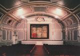 <p>Photographed prior to restoration and with the modern screen removed, showing the original painted silent screen on the rear wall.</p>