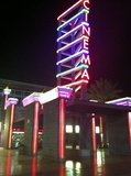 Entrance lit by neon at night