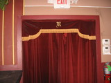 Monogrammed valence over house right exit Ruffin Theater