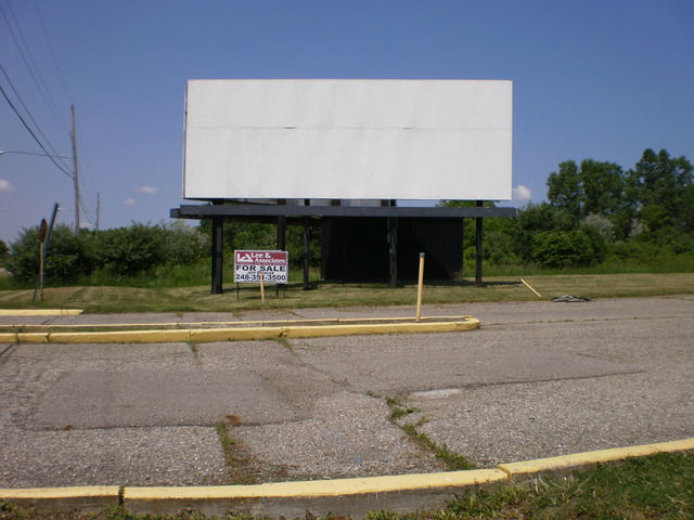 Boarded up attraction board of closed Miracle Twin DI.