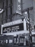 <p>A specially lettered marquee for Fire Prevention Week, October 1955.  The film was Desert Sands, the side of the marquee is still being changed.  A rare night photo. Courtesy of the Fire Museum of Memphis, used with permission.</p>