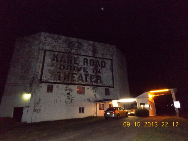 Night photo of back of screen tower and box office
