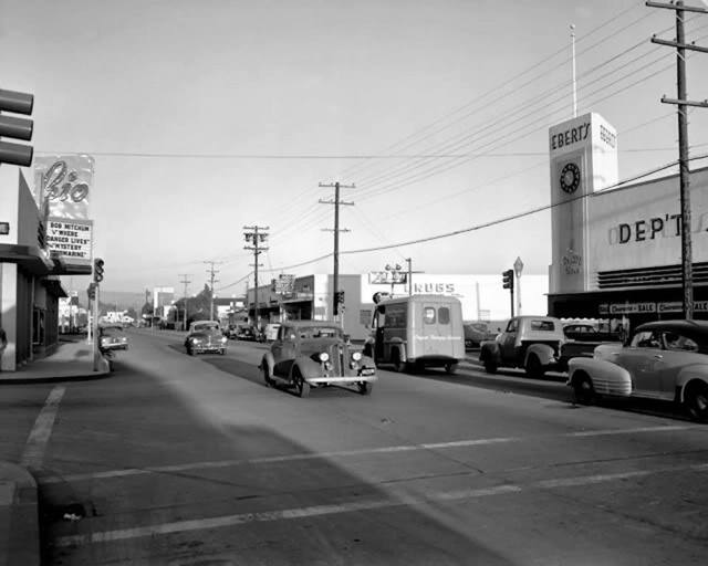 Rio Theatre marquee on the left in 1950. Photo via AmeriCar The Beautiful Facebook page.