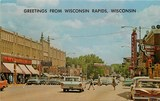 Postcard with the Wisconsin blade sign circa 1960.