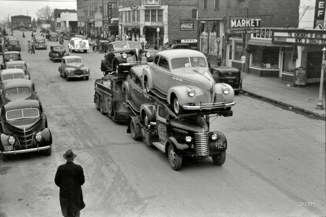 1940 Pontiacs on delivery truck in front of Chief Theatre. 35mm nitrate negative by Russell Lee for the Farm Security Administration via Library of Congress via Shorpy FB page.