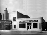 <p>The Beverly Hills Shopping Center consisted of the theater and the pharmacy next door which were both sold to Robb & Rowley circuit in 1947.</p>