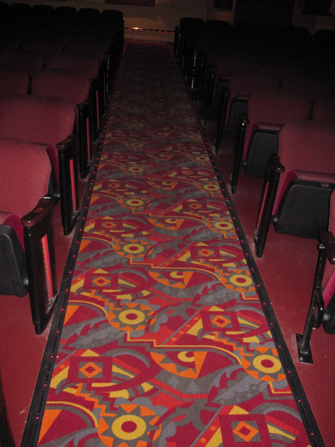 Aisle carpeting, with runner lights