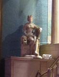 Statue at right of proscenium