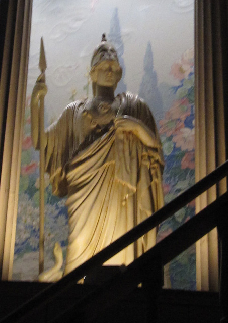 Statue in right front corner of auditorium