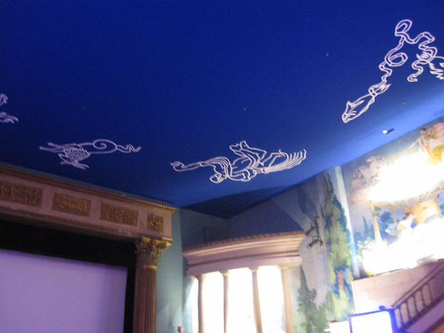"Ceiling with blue ""sky"" and zodiac symbols."