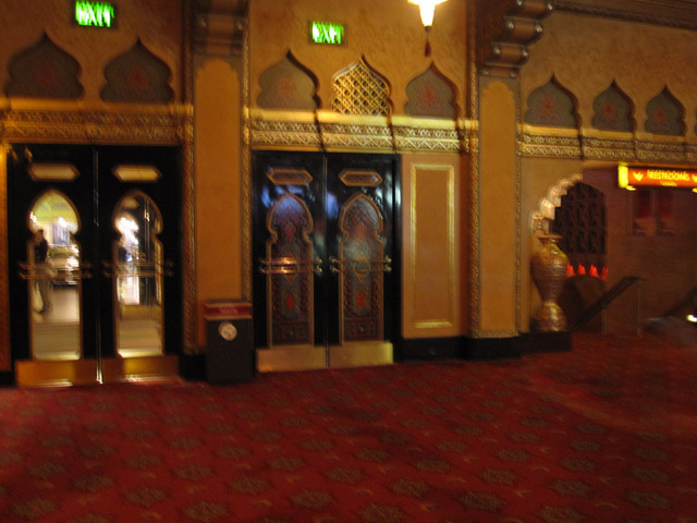 Doors to outer lobby on left; stairs to lower mezzanine on right.