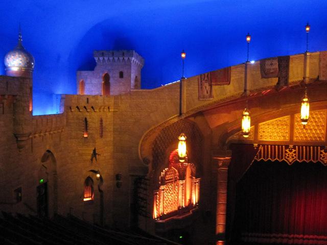Left side of proscenium showing atmospheric ceiling